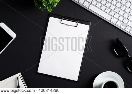 Office Desk Table With Clipboard, Computer Keyboard, Coffee Cup, Smartphone, Notepad And Pen. Top Vi
