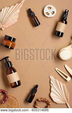 Set Of Amber Glass Bottles With Natural Cosmetic And Dried Flowers. Beauty Product Branding, Packagi