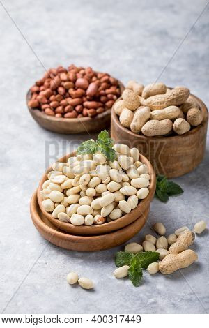 Raw Dried Fresh Peanut Nuts On A Stone Background. Peanut Nuts In A Small Plate On A Vintage Wooden