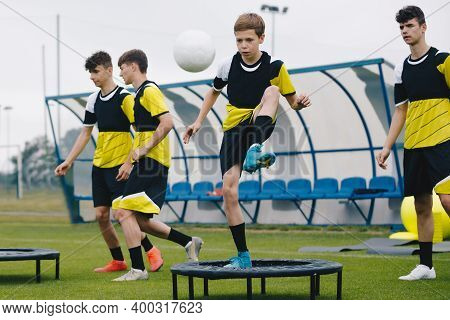 Youth Team On Football Training. Teenagers On Football Trampoline. Group Of Young Boys In Sports Soc