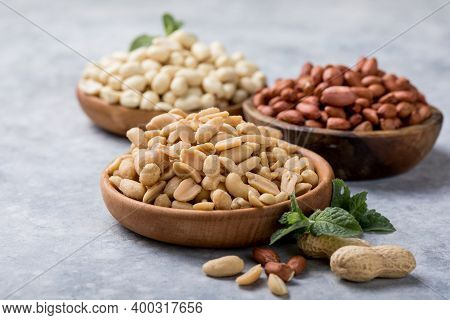Roasted Salted Peanuts. Crispy Nuts In Bowl On Stone Table.peanut In Nutshell On Rustic Table In Bow
