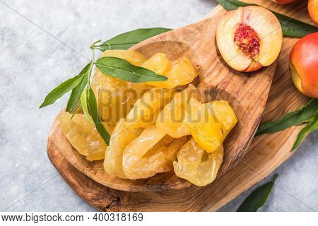 Peaches. Peach Dry. Dried Fruits Or Candied And Fresh Peaches With Leaves On Stone Background