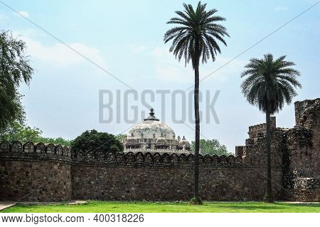 Ancient Fortress Wall And Dome Of The Old Mughal Tomb - A Sample Of Indian Muslim Architecture Of Th