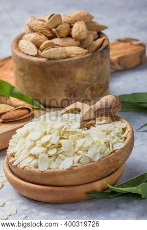 Raw  Almond Petals For Confectionery. Almond Nuts In Wooden Shovel, Almonds With Shell In Bamboo Bow