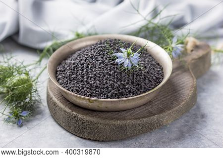 Black Cumin Seeds With Nigella Sativa Flower On White Background. Black Cumin Seeds Essential Oil ,