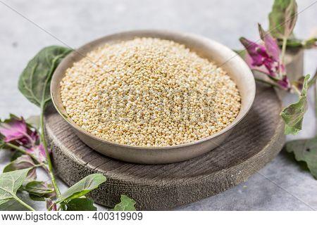 Raw White Quinoa Seeds (lat. Chenopodium Quinoa) On Plate. Chenopodium Quinoa