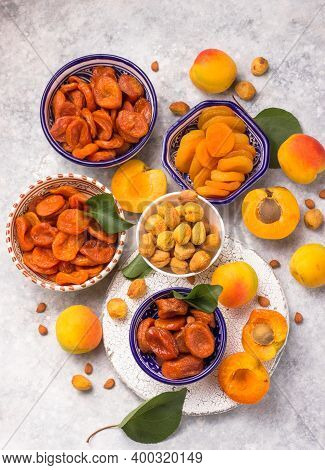 Composition From Different Varieties Of Delicious And Healthy Dried Apricots  On A Light Background