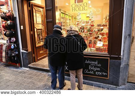 Brussels, Belgium - November 19, 2016: People Visit A Gourmet Belgian Chocolate Store In Brussels. T