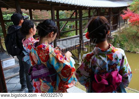 Kyoto, Japan - November 26, 2016: Women Visit Kodaiji Temple Gardens In Kimono Costumes In Kyoto, Ja