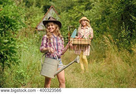 Girls With Gardening Tools. Child Friendly Garden Tools Ensure Safety Of Child Gardener. Cute Garden