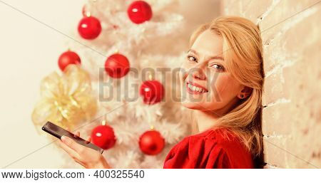 Woman Pretty Peaceful Dreamy Face Hold Smartphone Enjoy Mobile Phone Conversation. Girl Near Christm
