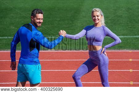 Training With Coach. Fitness Partners. Athletic Man And Woman Compete In Armwrestling. Male And Fema