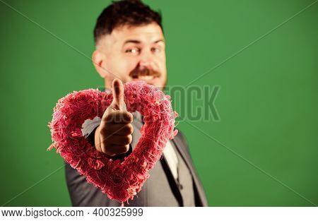 Romantic Macho Flirting. Happy Valentines Day. Hipster Hold Heart Symbol Love. Man Formal Suit Celeb