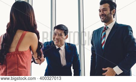Job Seeker And Manager Handshake In Job Interview Meeting At Corporate Office. The Young Interviewee