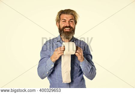 The Highest Quality. Hygiene And Sanitary. Man In Public Toilet. Diarrhea Concept. Man Holding Toile
