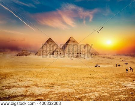 Egyptian Pyramids In Sand Desert And Clear Sky