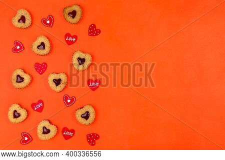 Linzer Cookies In The Shape Of A Heart And A Valentine On A Red Background With A Copy Of The Space.