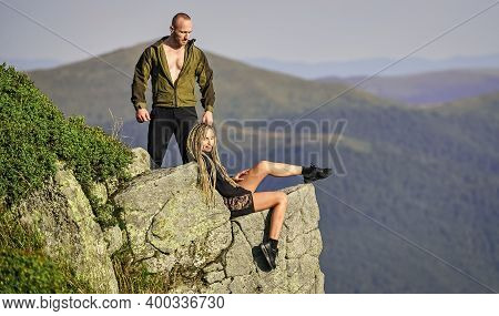 Couple Hikers Enjoy View. Hiking Benefits. Hiking Weekend. On Edge Of World. Woman Sit Edge Of Cliff