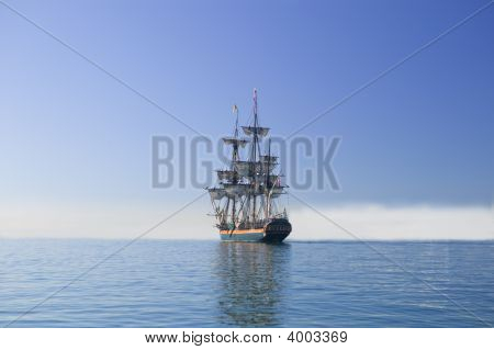 Tall Ship Sailing At Sea Under Full Sail