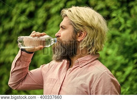 Moisturize Dry Mouth. Bearded Mature Man Drinking Some Water. Fresh And Healthy Water From Bottle. H