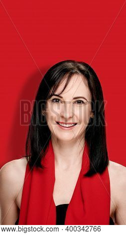 Smiling Bright Brunette Posing In Silk Shawl On Red Background, Image Oriented For Smartphone