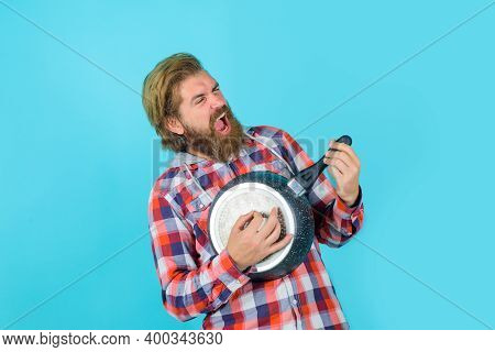 Bearded Man Having Crazy Fun. Playing On A Frying Pan Like A Guitar. Crazy People. Happy Man. Emotio