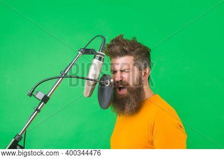 Bearded Man Sing In Microphone. Karaoke. Man Singing With A Microphone. Singing In Studio. Microphon