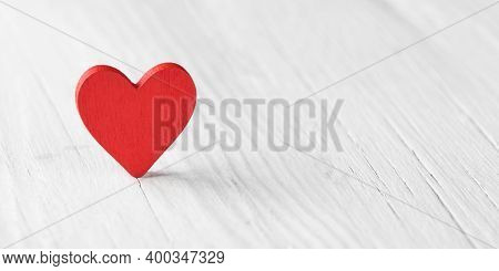 Red Heart On A White Wooden Background