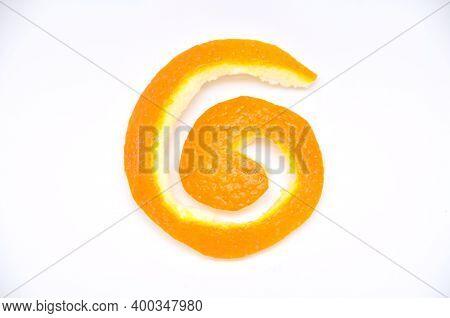 A Peeled Cut Orange Peel, Isolated On White Background