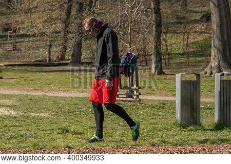 Prague, Czech Republic. 03-11-2020. Young Man Walking In Park Stromovka. Covid-19 It Is A World Spre