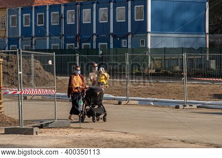 Prague, Czech Republic. 03-11-2020. Couple With A Baby And Pram Walking In Park Stromovka. Covid-19