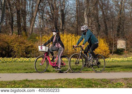Prague, Czech Republic. 03-11-2020. Friends Riding On Bike In Park Stromovka. Covid-19 It Is A World