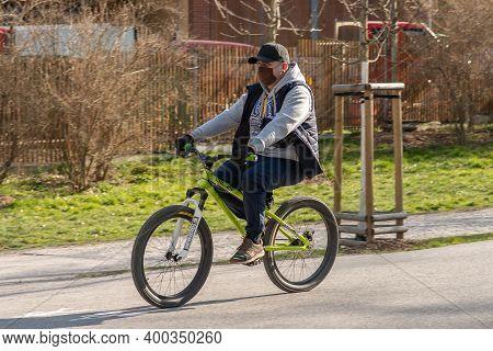 Prague, Czech Republic. 03-11-2020. Guy Riding On Bike In Park Stromovka. Covid-19 It Is A World Spr