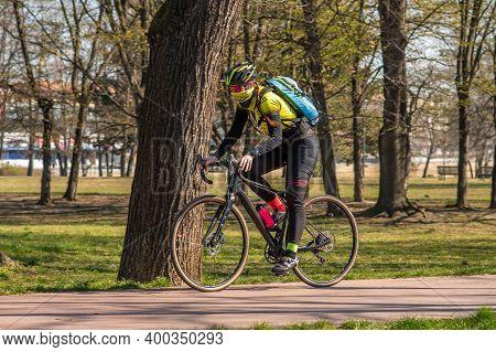 Prague, Czech Republic. 03-11-2020. Woman Riding On Bike In Park Letna. Covid-19 It Is A World Sprea