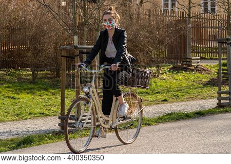 Prague, Czech Republic. 03-11-2020. Woman Riding On Bike In Park Stromovka. Covid-19 It Is A World S
