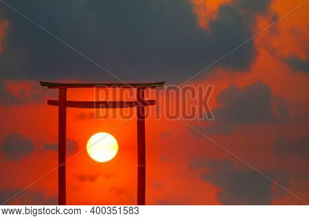 Reflection Torii Sunset Red Gray Cloud On Sky Over The Sea