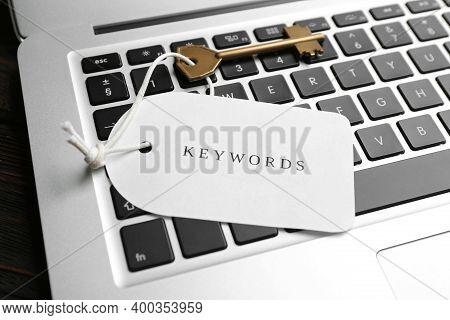 Key With Tag Keywords On Laptop Keyboard,  Closeup