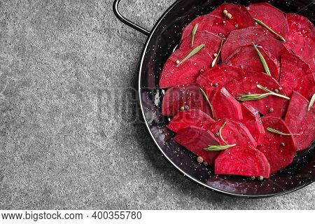 Slices Of Raw Beetroot In Wok Pan On Grey Table, Top View. Space For Text