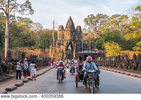 Siem Reap, Cambodia : December-18-2018 : Tuk Tuk Carrying Tourist For Visiting Angkor Thom An Ancien