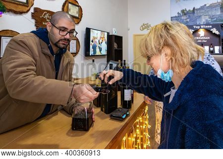 Bethlehem, Israel, December 09, 2020 : Winery Manager Invites Visitors To Taste The Products In The