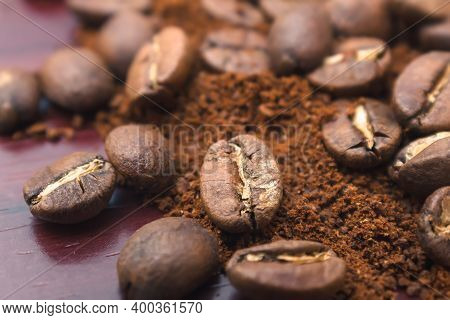 Roasted Coffee Beans Are Placed On Top Of Ground Or Instant Coffee