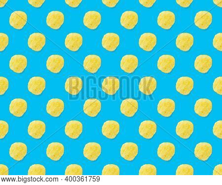 Seamless Pattern Made From Potato Chips On Light Blue Background Flat Lay. Potato Snack Chips Isolat