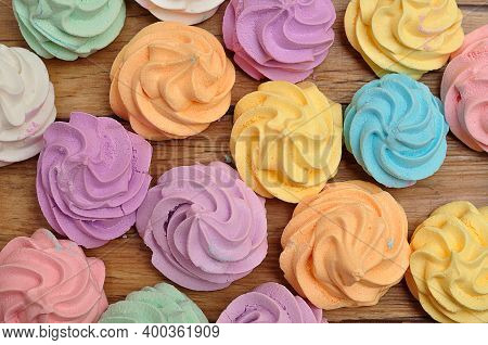 Full Frame Of Pastel Color Meringues  On  A Wooden Table