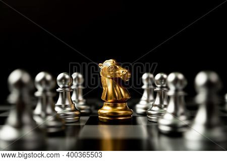 Golden Chess Horse Standing To Be Around Of Other Chess, Concept Of A Leader Must Have Courage And C