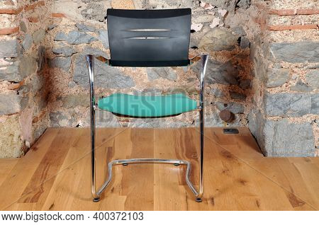 Comfortable And Stylishly Designed Black And Green Office Chair In Front Of A Wall