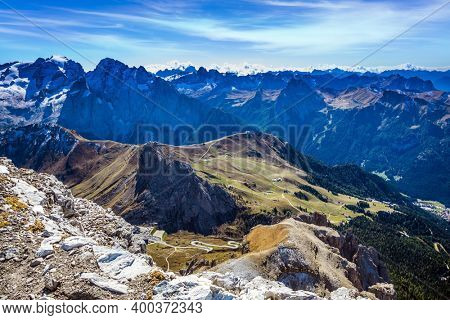 The Passo-Pordoi pass. Pordoi is a mountain pass of the Dolomites, located between the Sella mountain range and the Marmolada mountain. Warm sunny day in the Alps
