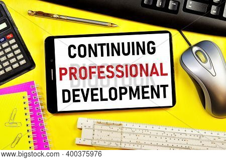Continuous Professional Development. Text Label On The Screen Of The Smartphone. A Planned Program O