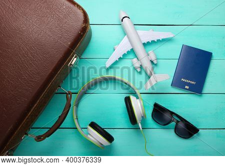 Travel Concept. Old Luggage And Travel Accessories On Blue Wooden Background. Flight Voyage, Trip, J