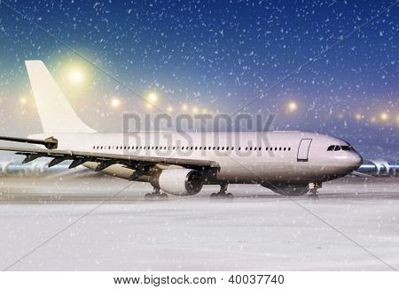 airport and white aircraft at non-flying weather, winter time
