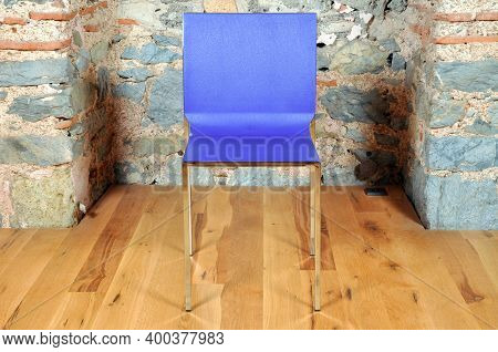 Comfortable And Stylishly Designed Blue Office Chair In Front Of A Wall